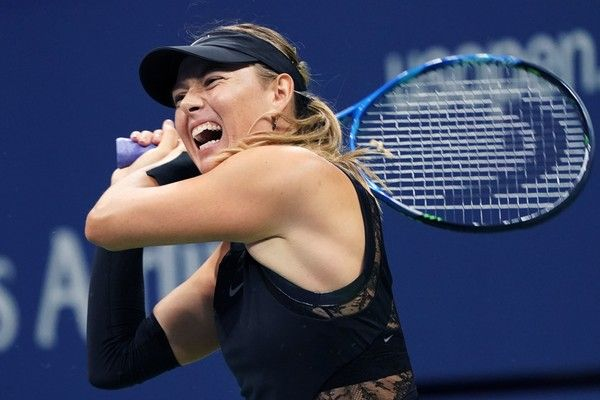 Russia's Maria Sharapova returns the ball against Sofia Kenin of the US during their 2017 US Open Women's Singles match at the USTA Billie Jean King National Tennis Center in New York on September 1, 2017. / AFP PHOTO / Don EMMERT - 872 of 962