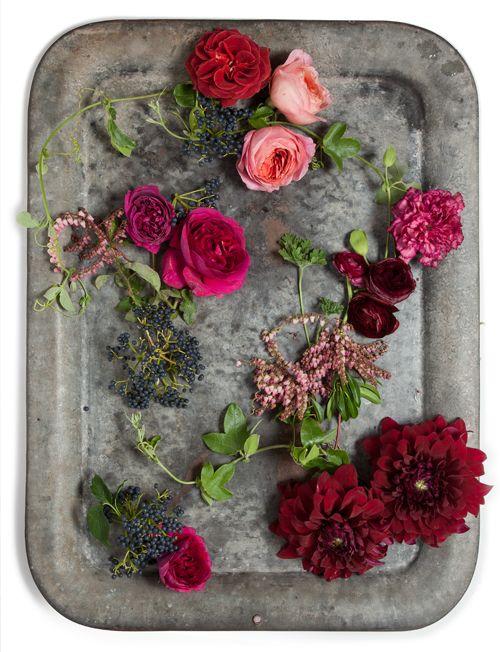 Clockwise from top: garden roses, carnation, rose geranium, ranunculus, andromeda, passion vine, dahlias, blueberry viburnum