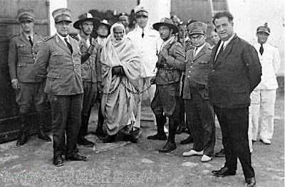 Omar al Mukhtar led the Libyan resistance to Italian colonization of Libya.(here he is captured  with handcuffs.)