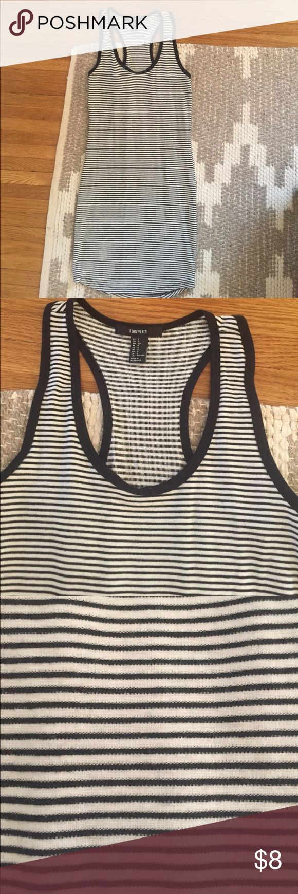 Forever 21 Black and White striped bodycon dress Fits snug to the body and drops above the knee with a racerback shape. This has been worn. Forever 21 Dresses Mini
