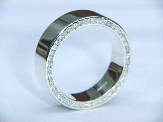 Handmade Wedding Ring 9k White Gold and F VS2 Diamond Channel Set  Wedding Bands. £825.00, via Etsy.
