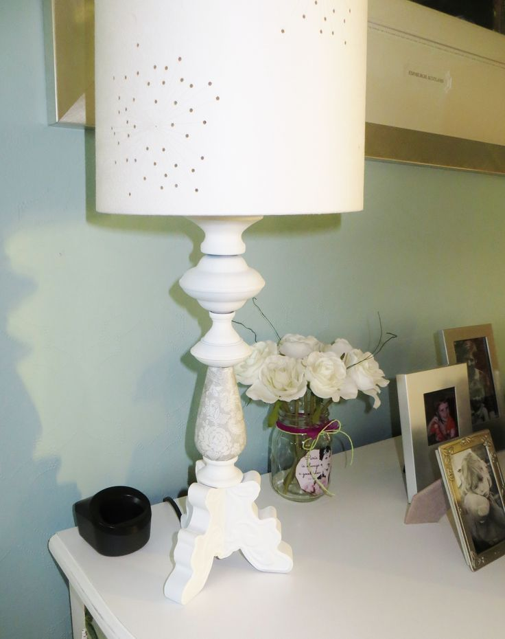 Painted and decoupaged, this lamp base was repurposed from a metal candlestick