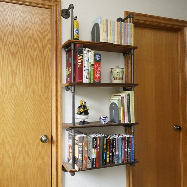 Hinged bookshelf for books with their hands between the door metal and copper pipes with his own hands photo