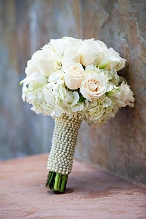 Beautiful blush pink roses with white hydrangea and pearl wrap. Stunning and elegant. - VintageWeddingIdeaswithPearlDetails | http://www.tulleandchantilly.com/blog/vintage-wedding-ideas-with-pearl-details/