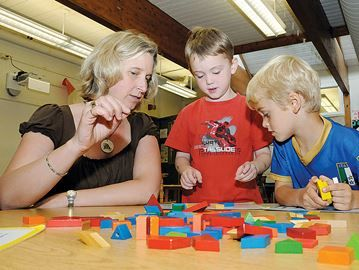 Trustee job different, equally important: expert - Kindergarten teacher Lori Hornick's works with students Rudi Urbach, centre, and Everett Faulkner at Steele Street Public School last June. While school board trustees used to deal with curriculum, teachers' salaries and other vital functions, the role has been eroded, a former board member says.