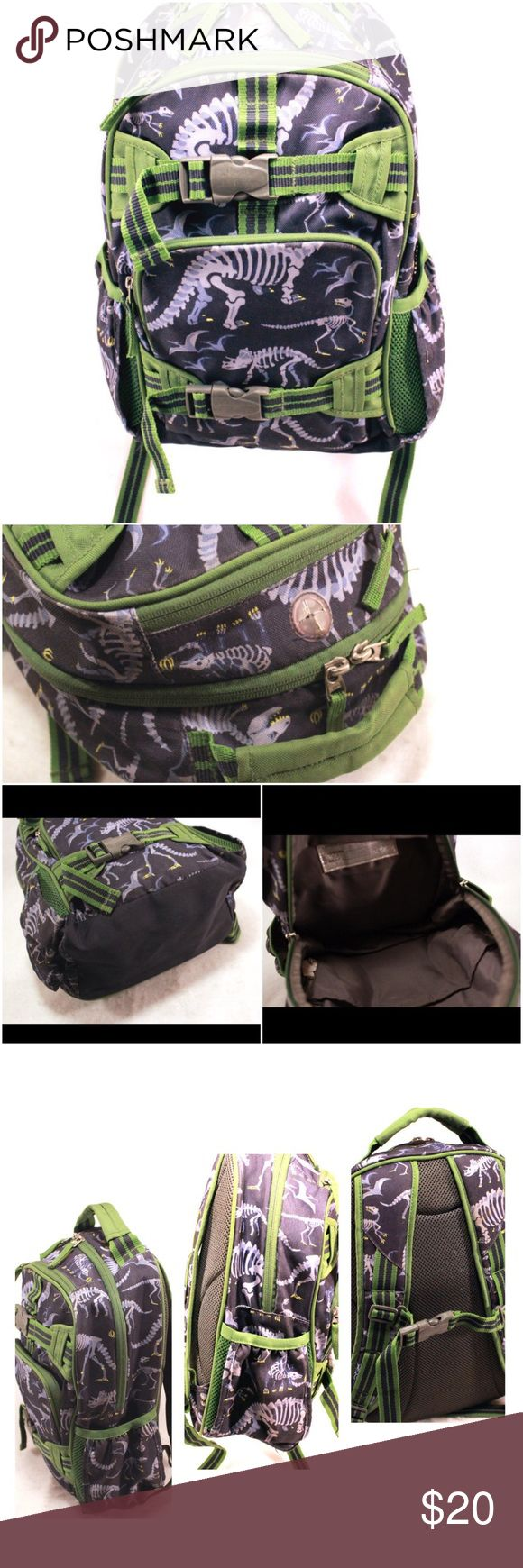 "POTTERY BARN KIDS Navy and Olive Dinosaur Backpack POTTERY BARN KIDS Navy and Olive Dinosaur Backpack.  Super durable and functional, the rugged, roomy Mackenzie backpack has numerous pockets, straps and gear loops. Made of water-resistant polyester with adjustable padded shoulder straps. Exterior straps hold a lunch bag. Exterior side pockets. 14.5x16x5.5"" with 2"" strap drop. Name written inside.  Otherwise fantastic condition.  Fun for those of us who still love dinos! Orig. $69. Pottery…"