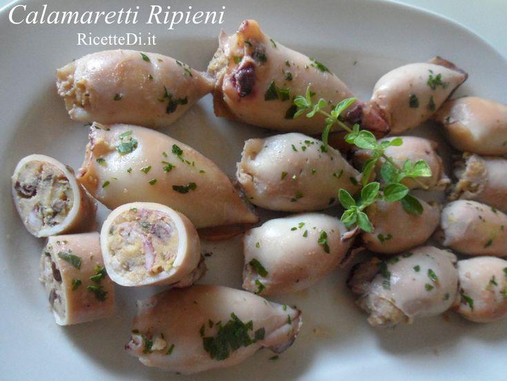 Calamaretti ripieni con patate, uova, parmigiano, pecorino e olive, e poi saltati in padella con olio e aglio e sfumati con un bel bicchiere di vino bianco