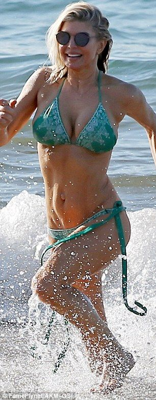 Stunning lady:No doubt all that time Fergie has spent dancing on stage has helped whip her into amazing shape