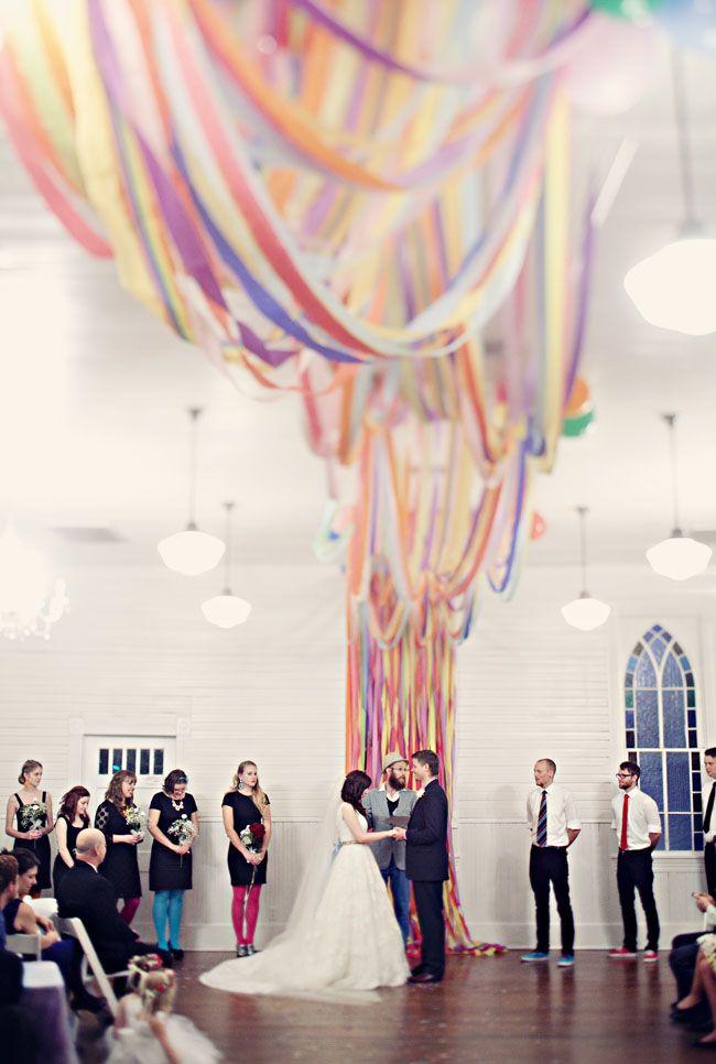 Rainbow streamers for wedding backdrop! Photo by Clayton Austin.