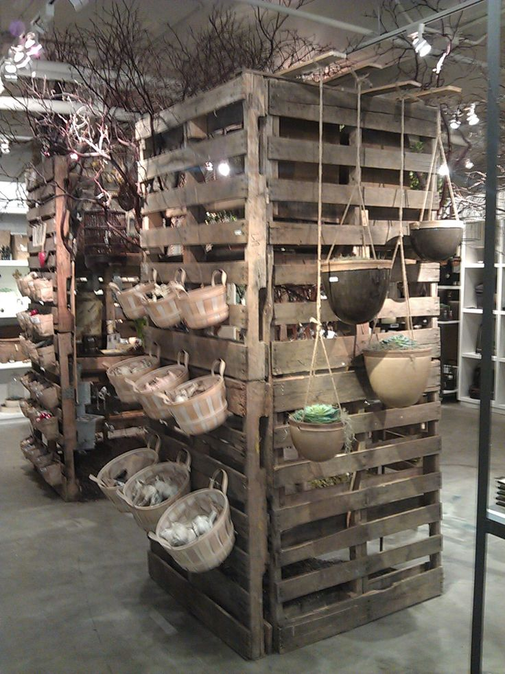 AmericasMart using Pallets. wood buckets for small items.