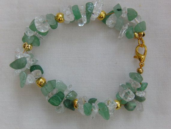 Green Jade and Clear Quartz Chip Bead Bracelet, Gold Plated Spacer Beads, Gift, Birthday, Anniversary, Christmas, Accessories, Jewellery  Really attractive bracelet made using green jade and clear quartz chip beads. The bracelet is 18 cm in length and will fit an average size wrist. It also has a gold plated lobster clasp fastening. The bracelet would complement any outfit worn for a special occasion such as a wedding or prom and would also make an ideal gift for a bridesmaid or loved one…