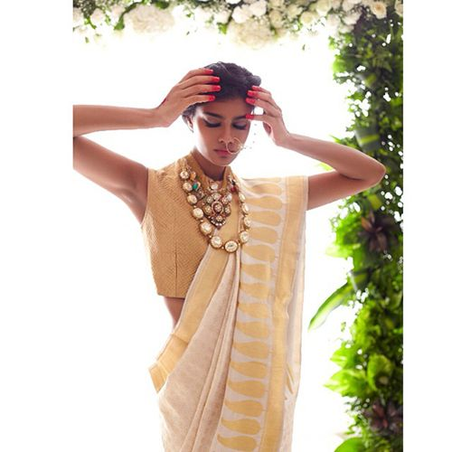 30 Gorgeous Sari Outfits— Traditional, Modern, & Unexpected #refinery29 http://www.refinery29.com/sari-outfits#slide12 A gold and ivory sari, styled by stylist Nisha Kundnani.
