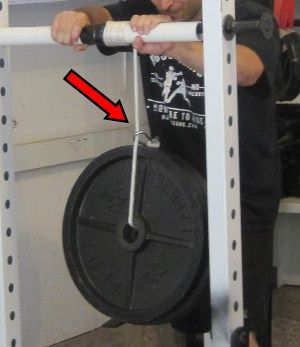 Homemade wrist rollers are fairly common and an excellent way to target the forearms.  Hand held versions are limited however, as you can only roll as much weight as you can hold.  If you wish to roll more weight, an axle mounted version is an inexpensive option (assuming you have somewhere to mount it).  Instructions …