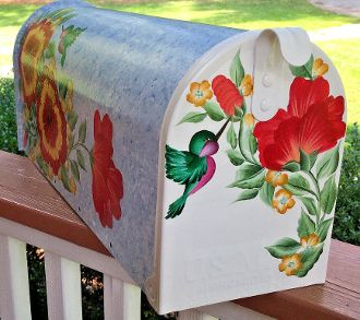 hand painted mailboxes with hibiscus flowers and hummingbird