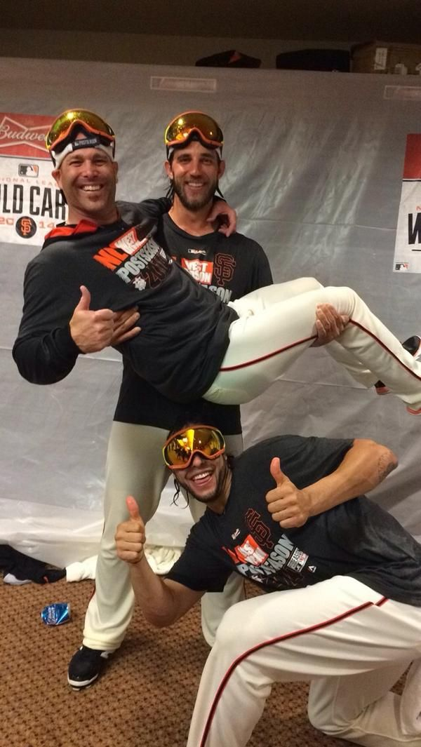 10/1/14. Great photo published by Tim Hudson's wife Kim with the hashtag #MadisonIsJustPlainStrong. This photo, taken after the Giants beat the Pirates in the 2014 Wild Card game, shows pitcher Madison Bumgarner carrying Tim Hudson like he only weighs 30 pounds. (Michael Morse signals all systems are GO for another run at the World Series!)