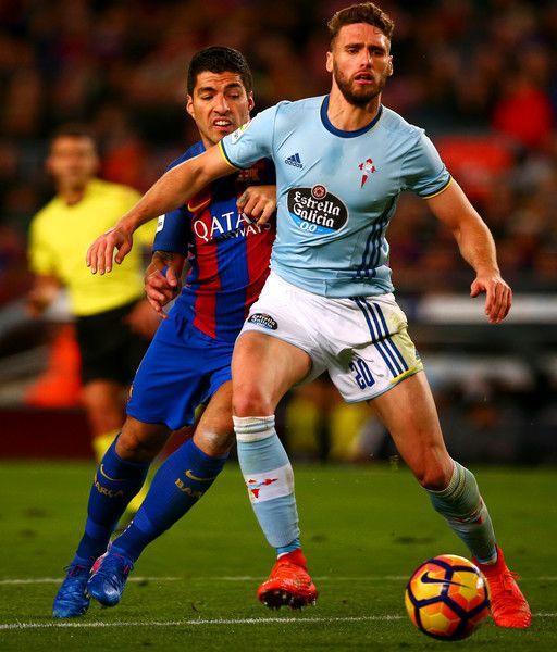 Luis Suarez of Barcelona battles for the ball with Sergi Gomez of Celta Vigo during the La Liga match between FC Barcelona and RC Celta de Vigo at the Camp Nou on March 4, 2017 in Barcelona, Catalonia.