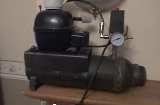 Airbrush Compressor by mrwrigley1 -- Homemade airbrush compressor constructed from a surplus refrigerator compressor and gas bottle, pressure switch, pressure gauge fittings, filter, and hose. http://www.homemadetools.net/homemade-airbrush-compressor-2