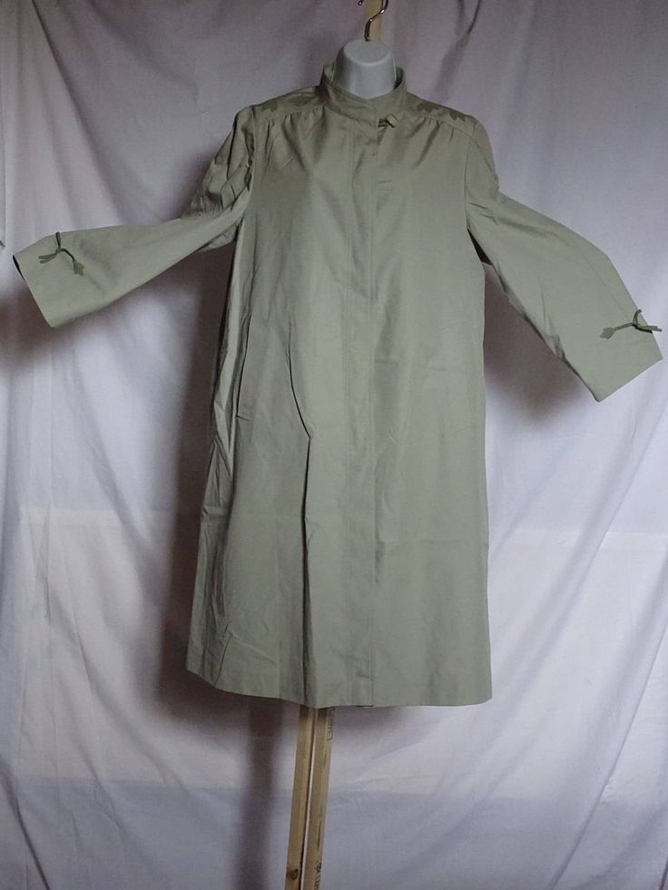 Vintage classic ladies raincoat / mac / trench coat in pale olive colour  with floral motif design on shoulders and cuffs by Back2Theyesteryear on Etsy