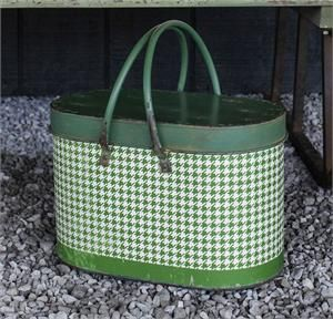 With plenty of vintage style, this Green and White Houndstooth Metal Picnic Basket is just what you need to pack up a little snack to bring along on your outing to find the perfect Christmas Tree. The cheerful country houndstooth pattern fits well with farmhouse decor. Use it to store magazines, knitting supplies, and so much more. Features a cover, handles and an aged finish.