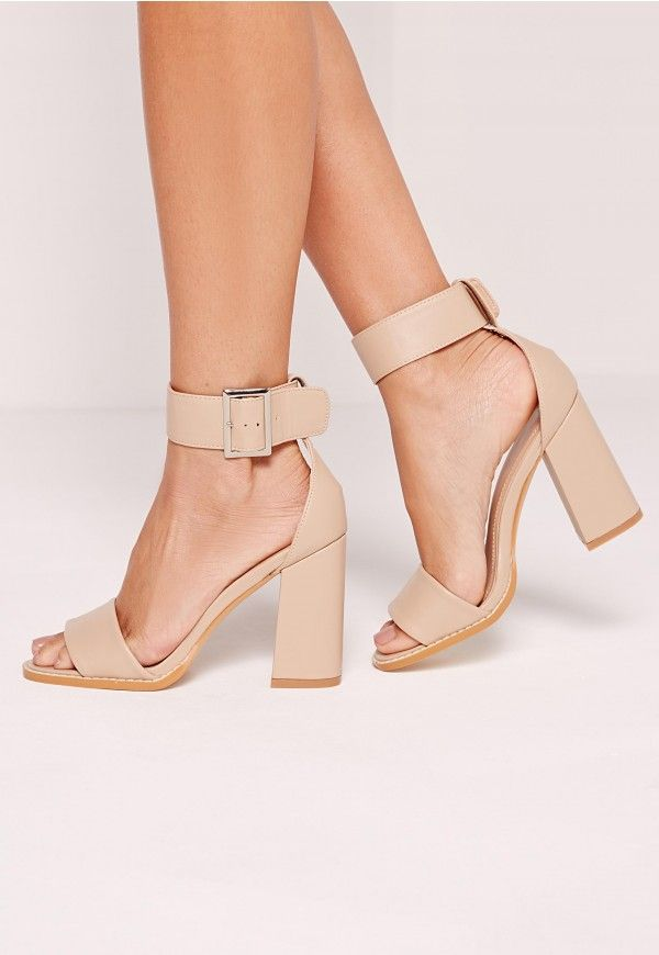 We have this thing about shoes where we need to, like, buy them all! Feed your obsession and add a new addition to your shoe-drobe with these classic block heeled sandals. In classic black with silver buckle detailing and faux leather finis...