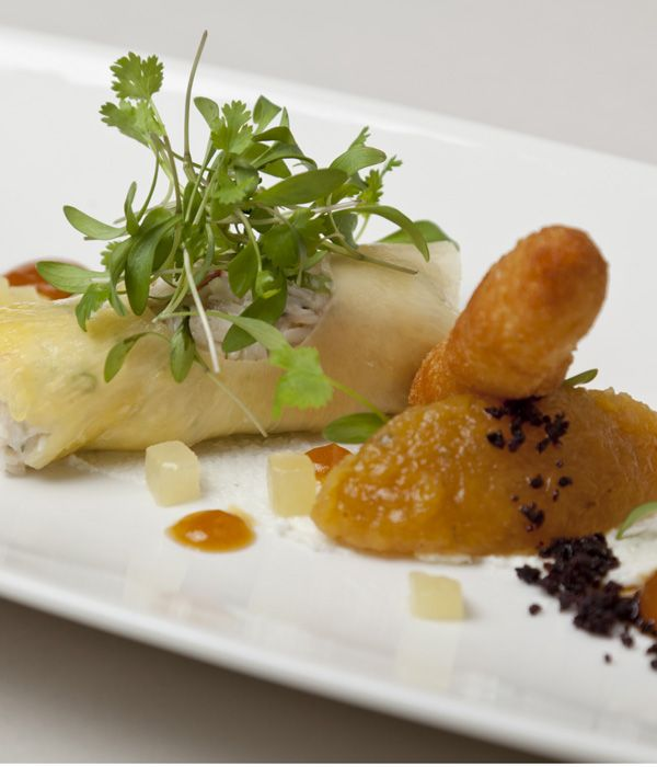 In this sublime crab recipe from Simon Haigh, dressed crab is served with a sticky pineapple chutney and a delicious goats cheese beignet. Don't be put off by the plating, as this seafood dish is relatively straightforward to put together.