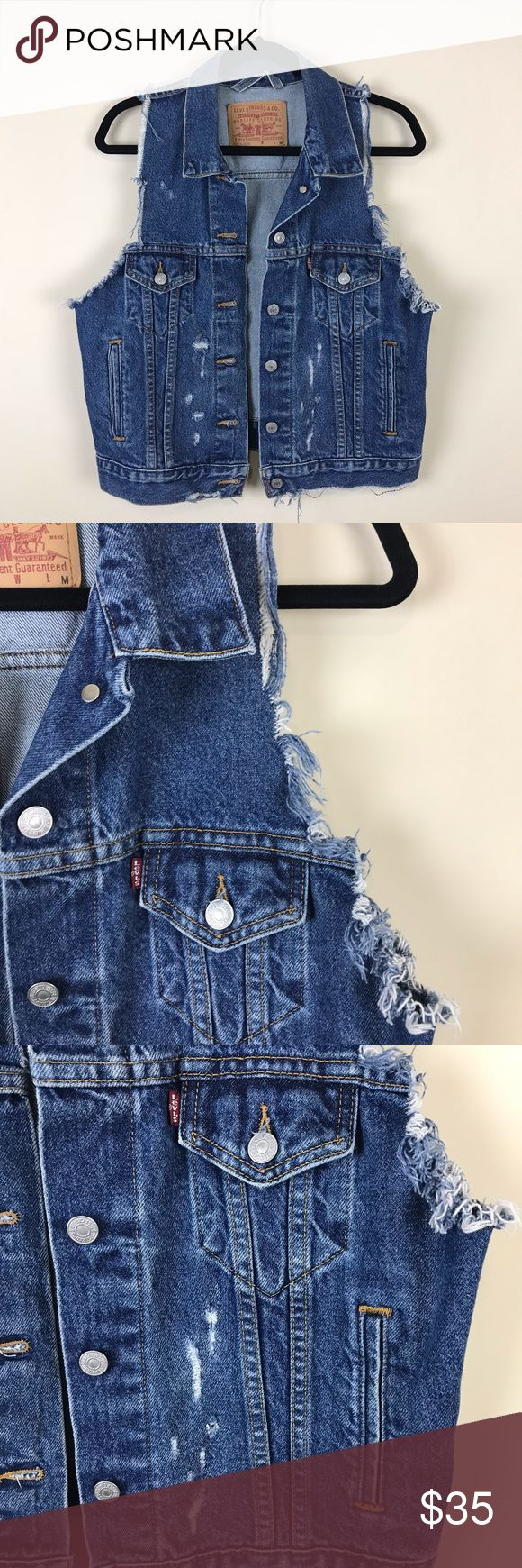 "LEVIS DISTRESSED DENIM JACKET VEST MEDIUM LEVIS MEDIUM DISTRESSED DESTROYED BLUE DENIM JEAN JACKET VEST. RAW HEM SLEEVES. BLEACH SPOTS THRU OUT. WOMEN MEDIUM. NO FLAWS. PIT TO PIT 20"" LENGTH 21"" J THROWBACK 80S RETRO,HIPSTER,CASUAL Levi's Jackets & Coats Vests"