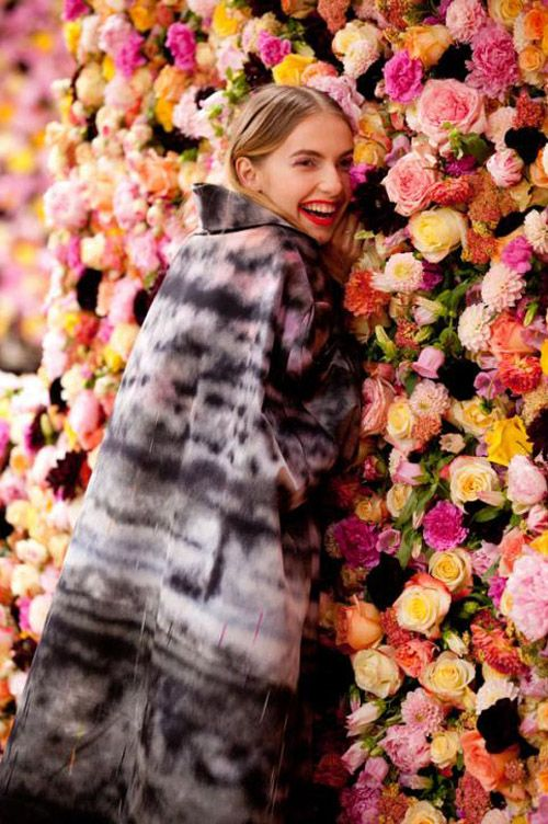 Fashion show Dior in Paris. Flower wall. Rose, Dahlia, Campanula.
