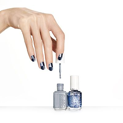 check+it+out+by+essie - checkmate!+quadrants+of+navy+cornered+against+glitter+make+a+winning+match+in+this+checkered+nail+design.