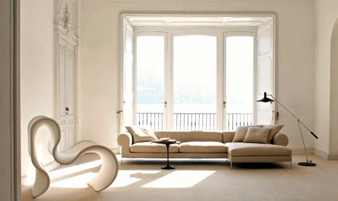 Beige Arm Sofa Design With Square Shape Ottoman Beside Black Floor Lights