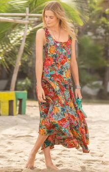 A floral silk maxi dress that combines elegance with an irresistible vivacity.