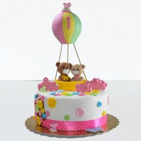 Cake in the form of hot air balloon and two teddy bears
