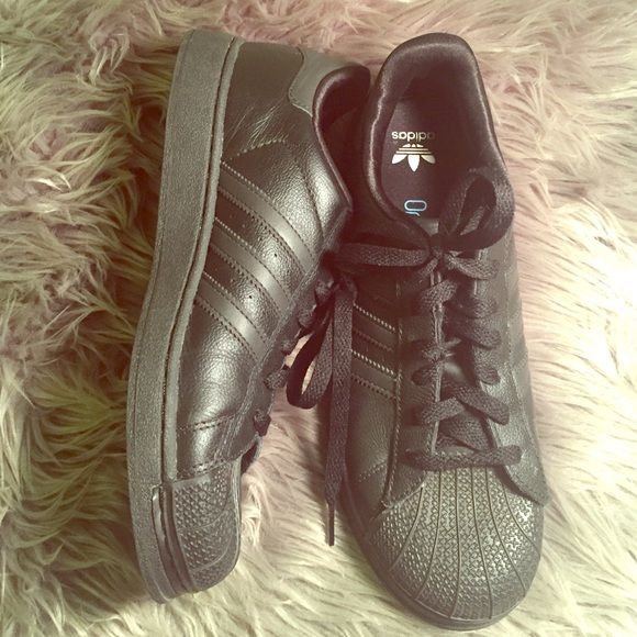 Black Adidas Superstar Men's 6 Women's 8 With ortholite. Rarely worn. These are vintage and don't have the super star lettering above the stripes but these are authentic. No flaws. I lucked out and got these vintage from my neighbor but I don't like all black shoes. Adidas Shoes