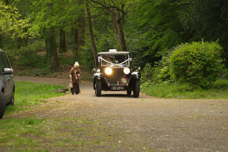 The bridal Rools Royce climbs the hill at the Abbey.