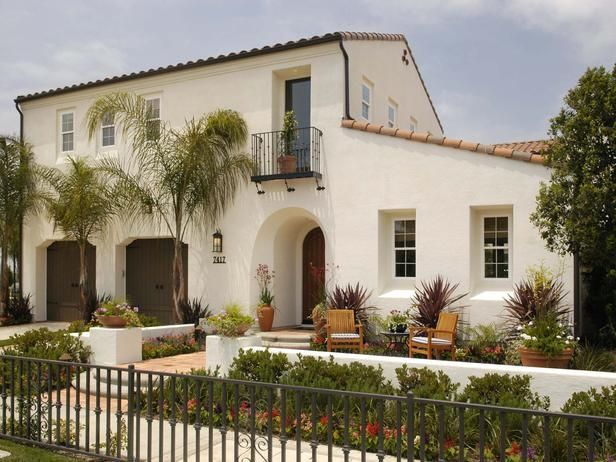 Spanish Style Home With Landscaped Front Patio A Simple Facade And .