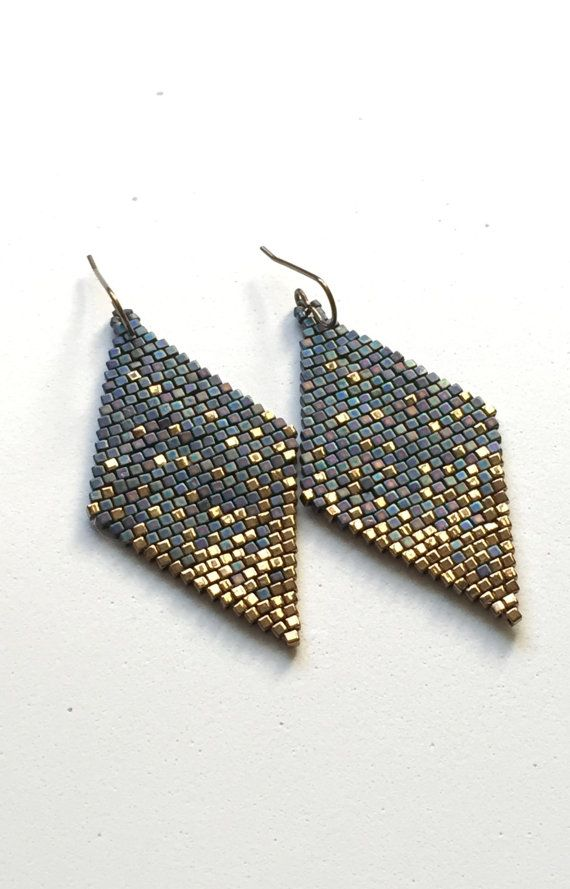 Iridescent Blue sprinkled with Gold. Made with premium quality glass cube beads, 1.8mm by Miyuki. Earring wires are Vintaj Brass. Length: 3.75 inches with ear hooks Width: 1.25 inches