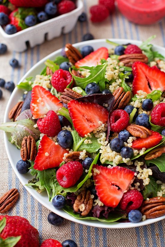Nothing says summer quite like a fresh, crisp, berry-topped salad! This berry pecan quinoa salad with homemade berry vinaigrette is perfect for lunch, dinner or to take to BBQs!