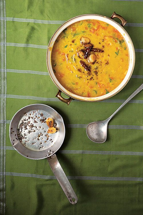 From SAVEUR Issue #167 Indian culinary expert Madhur Jaffrey experienced a version of this tarka—a combination of fried spices and aromatics stirred into a soupy dal—while visiting the South Indian city of Hyderabad. It is soured with tamarind and seasoned with curry leaves and mustard seeds.