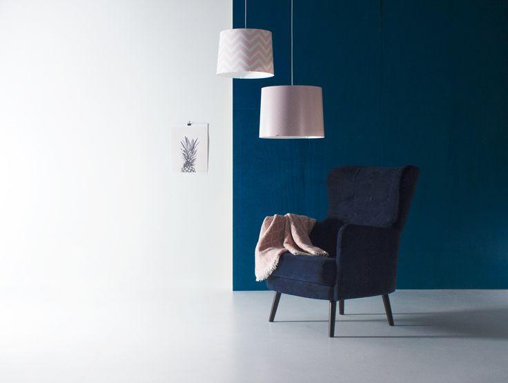 Pastel toned Switch pendants with navy blue velvet  Form armchair. Design by Jaakko Mäntylä