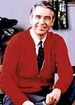 Fred Rogers was a saint. A beautiful and kind man. He NEVER gave the camera the finger...like in the b&w photo that's been circulating. It's a photoshop, and a cruel one at that. Here's snopes about it.   http://www.snopes.com/radiotv/tv/mrrogers.asp