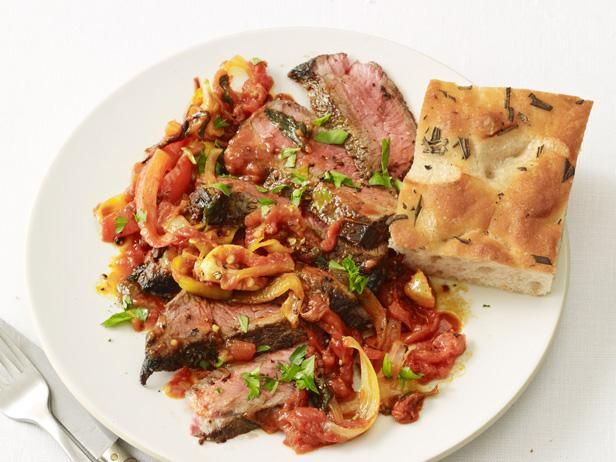 Steak Pizzaiola: Lean cuts of sirloin are simmered until tender and extra-flavorful in a garlicky tomato sauce for a healthier-than-it-tastes steak dinner in minutes.