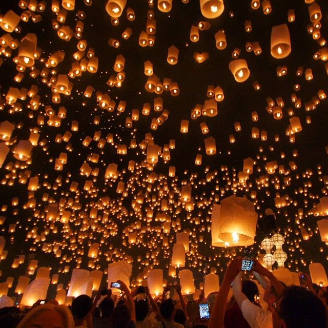 : Chiang Mai, Thailand --------------------------------------------------------- The Yi Peng lantern festival is awesome.. The thousands of lanterns in the sky left us in awe as we watched the flames multiply and illuminate the night sky. Visit Chiang Mai and participate in this unforgettable event by lighting your own lantern, and making a wish as it sets off into the sky.  #Thetravelbuggers ---------------------------------------------------------