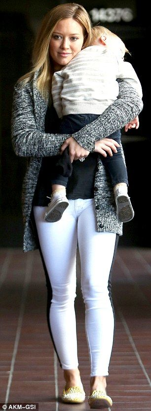 Simple staple pieces. Crisp white jeans, plain black tee, and a pretty cardi. Pulled together with flats, but riding boots or cute booties could work to.