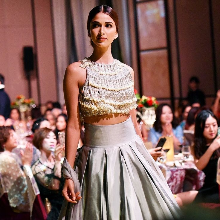 Embellished tops with fringes and a classic lehenga