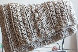 I found this free pattern in Ravelry, the Celtic Afghan pattern by Lion Brand Ya…