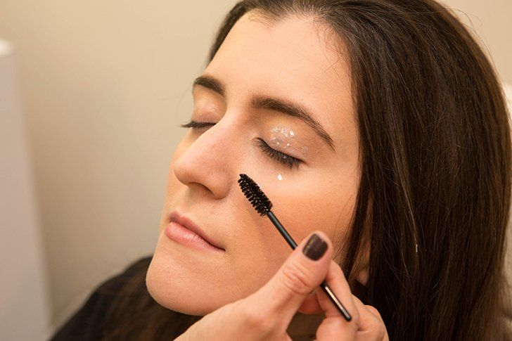 Pin for Later: How to Rock (and Remove!) Glitter Eye Makeup For New Year's Eve Fine-Tune You're sure to get glitter where you don't want it with this look, so use a dry mascara wand to get rid of any excess sparkle.