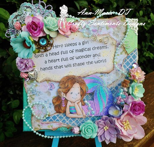 6 x 6 canvas made using Pebeo paints, downloaded Raspberry Road papers and Crafty Sentiments Designs 'mermaid day dream' stamp coloured with Prismacolor pencils.