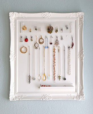 Idea: Maybe 2-3 of these hung on the wall across from my closet, to have my jewelry all displayed for me to grab before I walk out the door. But big frames-- maybe 1 foot or 1.5 foot squares. I dig the whites though.