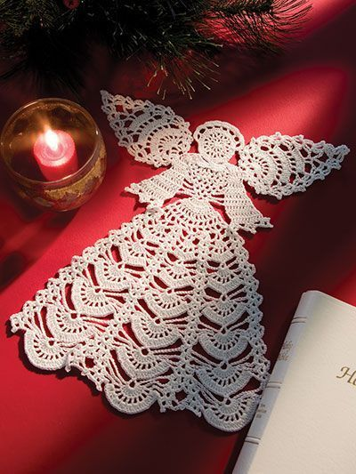 "Not just for holidays, this crochet angel is heavenly!   Display this beautiful crocheted angel doily year-round. It is made using size 10 crochet cotton. Finished size is 11 1/2"" x 10""."