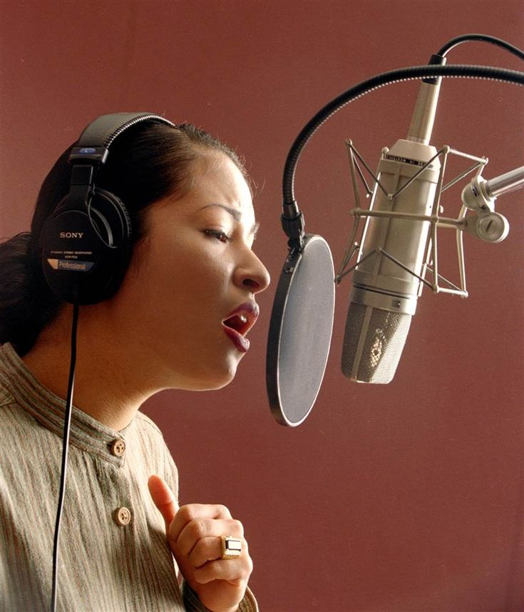 Selena works on one of her songs in a Corpus Christi studio in March 1995. Paul Howell / Houston Chronicle via AP file