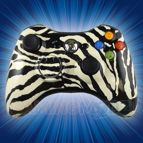 Zebra White Xbox 360 Modded Controller is a perfect gift for a special gamer in your life! All of GamingModz.com Xbox 360 modded controllers are compatible with every major game on the market today. If you decide to get one of our Xbox 360 or Playstation 3 modded controllers, your gaming experience will increase, overall performance will rise and it will allow you to compete against more experienced players.